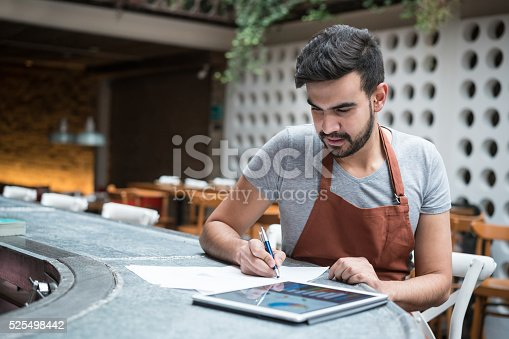 istock Business man doing the books at a restaurant 525498442