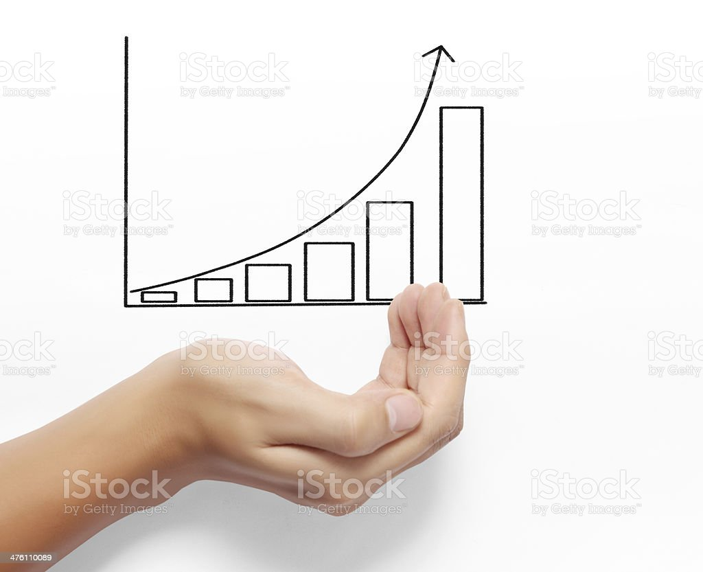 Business man drawing a graph royalty-free stock photo