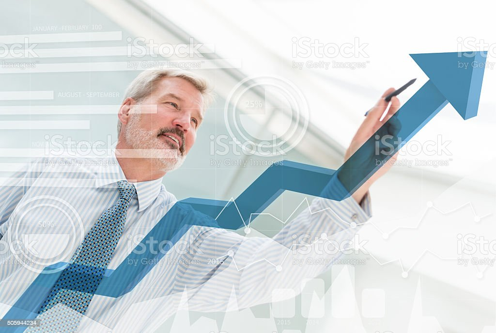 Business man drawing a growth graph Business man drawing a growth graph with an arrow pointing up 40-49 Years Stock Photo