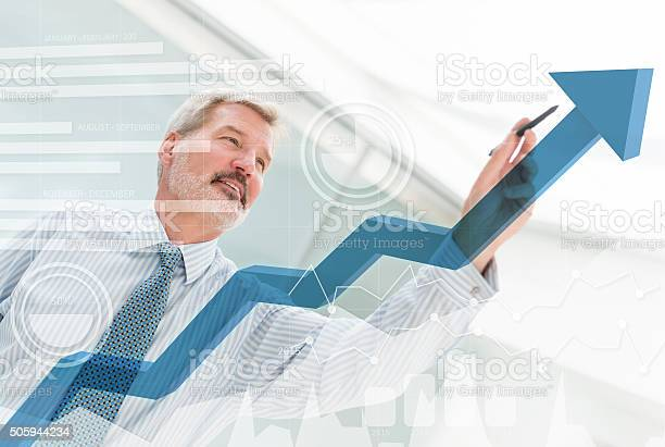 Business Man Drawing A Growth Graph Stock Photo - Download Image Now