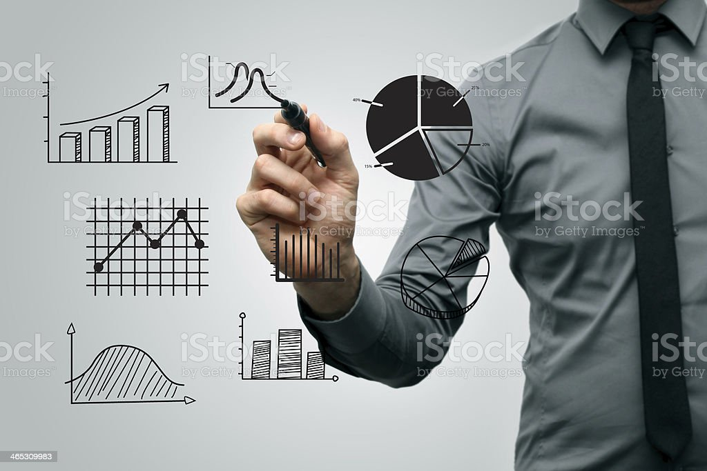 business man drawing different graphs and charts stock photo