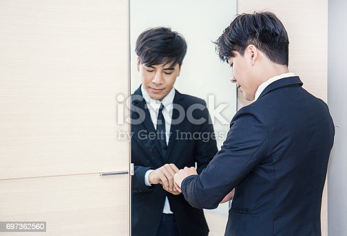 istock Business man dressing up for work 697362560
