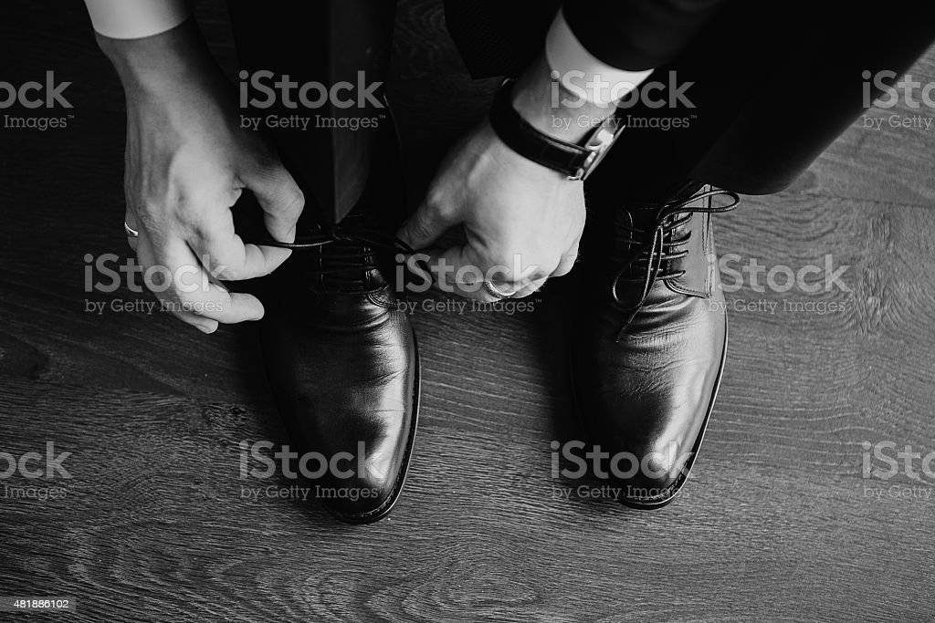 Business man dressing up with classic, elegant shoes. Groom wearing stock photo
