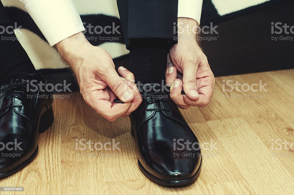 Business man dressing up with classic, elegant shoes stock photo