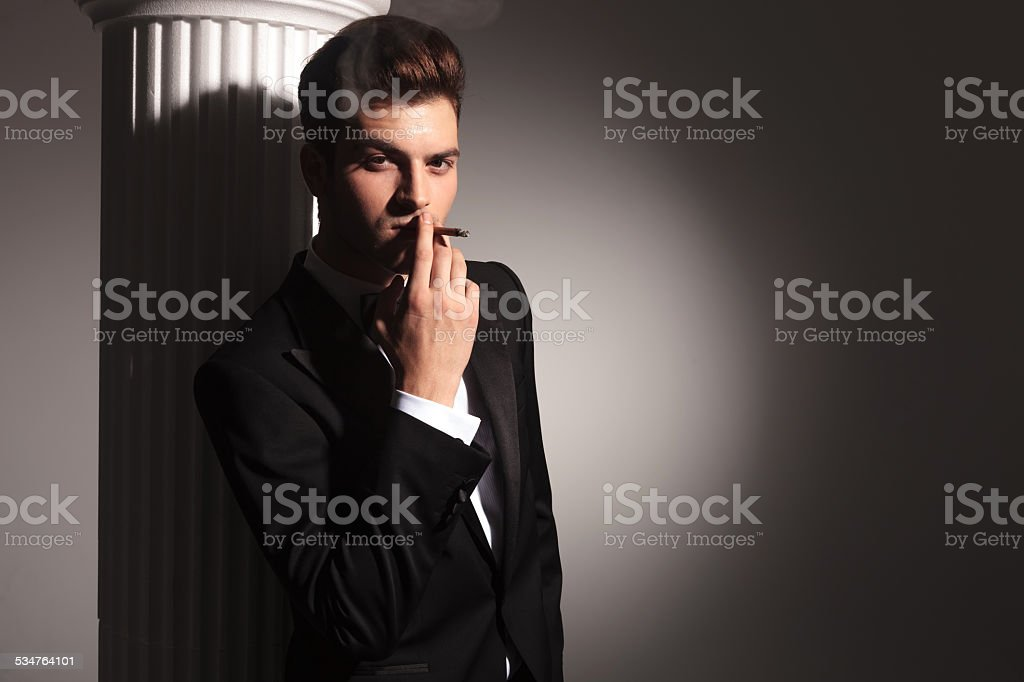 business man enjoying his cigarrete stock photo