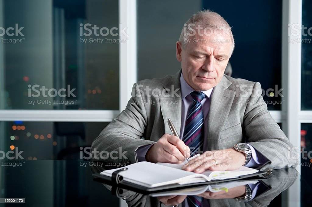 A business man filling in his portfolio stock photo