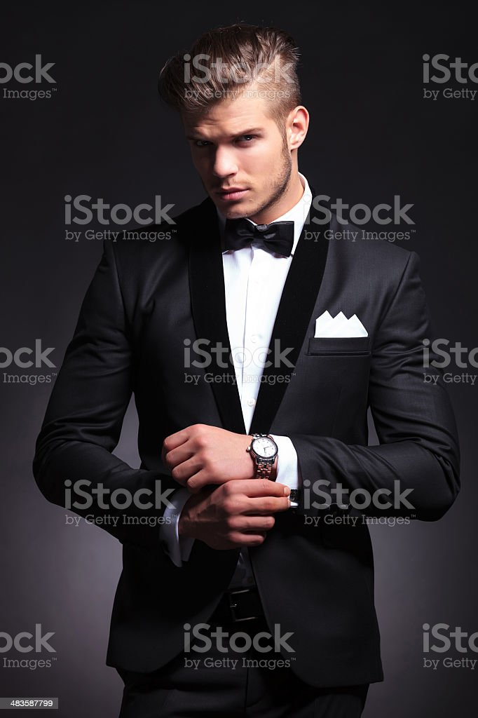 business man fixing cufflinks stock photo