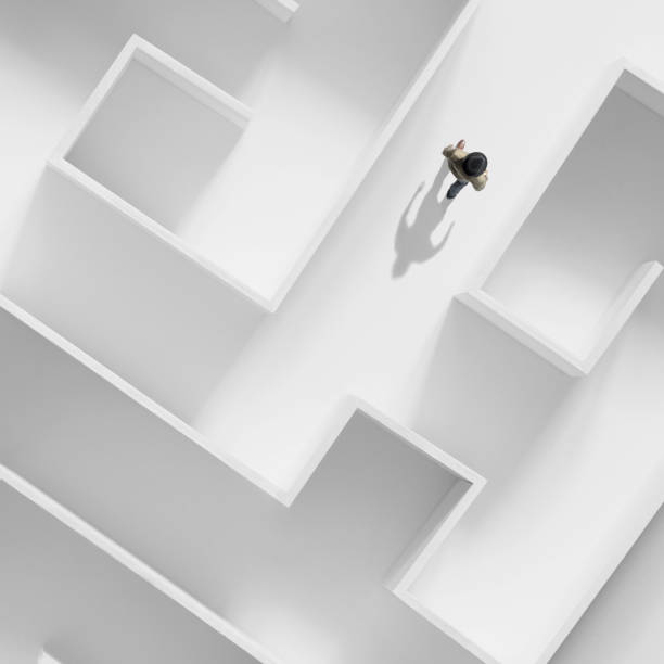 business man getting out of a complex maze, surreal abstract concept stock photo