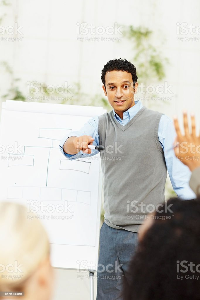 Business man giving a presentation to team royalty-free stock photo