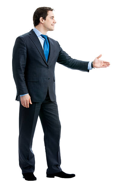 Business man giving hand for handshake, isolated stock photo