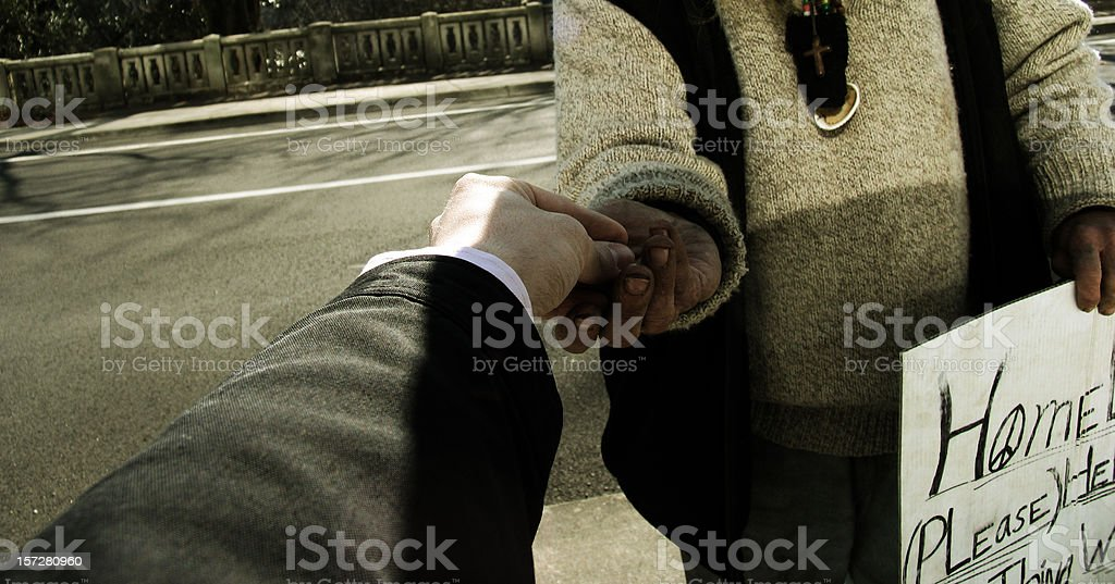 Business Man Giving Homeless Male Change royalty-free stock photo