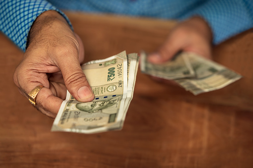istock A Business Man Giving Money 1172759554