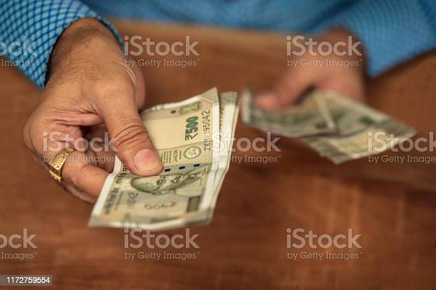 Business man giving money picture id1172759554?b=1&k=6&m=1172759554&s=612x612&h=e8xz0kcfz9kglsbloztsiruqutdgwhiy h806s5ocqk=