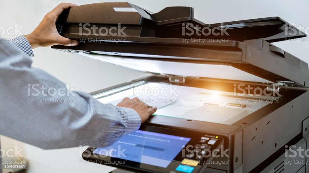 Business man Hand press button on panel of printer, printer scanner...