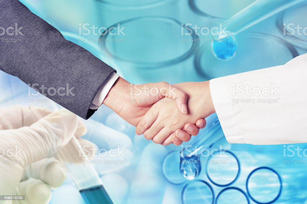 business man hand shake with researcher stock photo