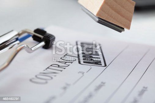 854317150istockphoto Business Man Hand With Rubber Stamp 465460291