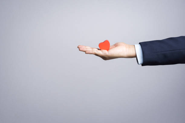 business man hand with wooden red heart object - passion stock pictures, royalty-free photos & images