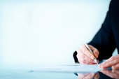 Business man hand writing on paper - Copyspace