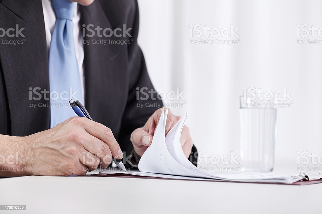 Business man hand writing on paper royalty-free stock photo