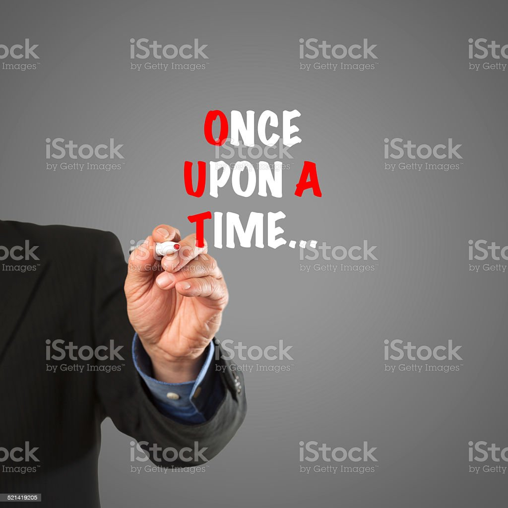 Business man hand writing 'Once upon a time' stock photo