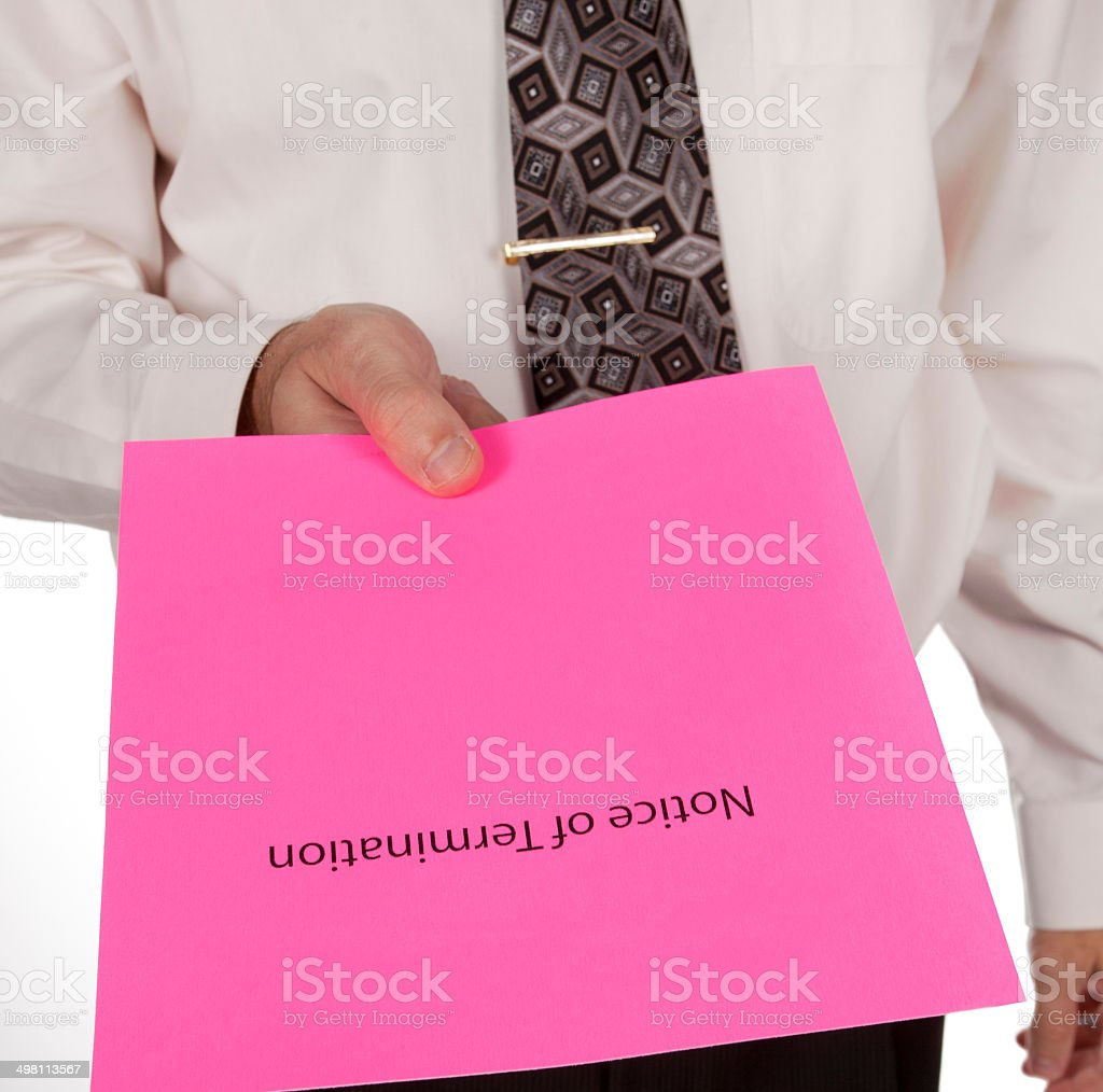 Business man handing out notice of termination or pink slip stock photo