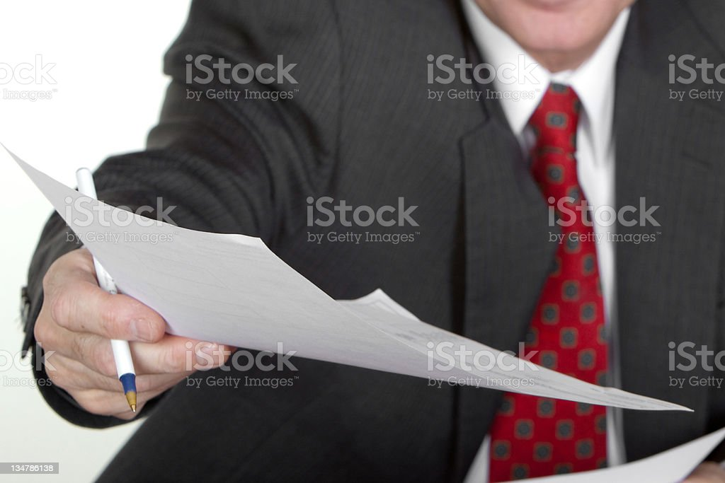 business man handing paper royalty-free stock photo