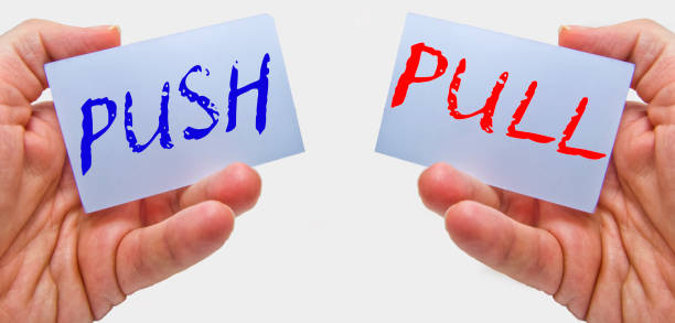 business man hands handling cards with push pull words business man hands handling cards with push pull words pulling stock pictures, royalty-free photos & images