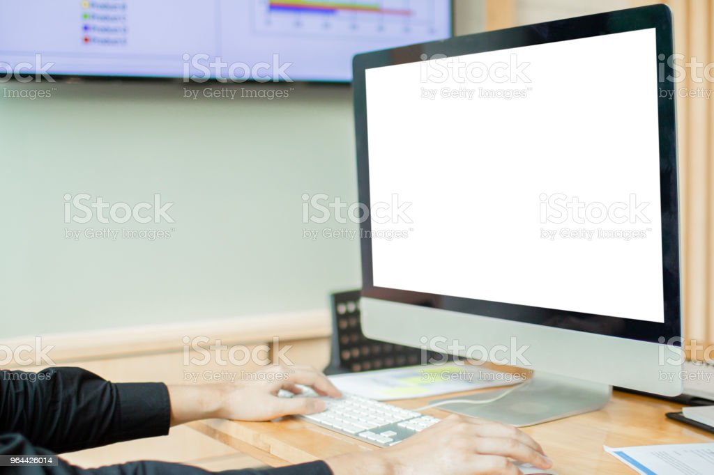 Business man hands using computer with blank screen on desk in cafe. instagram style filter photo vintage tone - Royalty-free Above Stock Photo