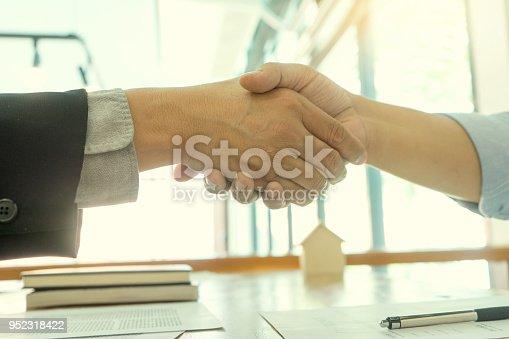 512011833istockphoto Business man handshake for sucess 952318422