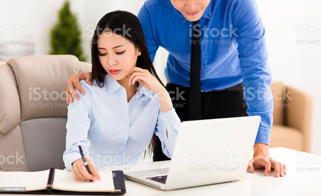 Business man harassing  colleague in office - foto stock