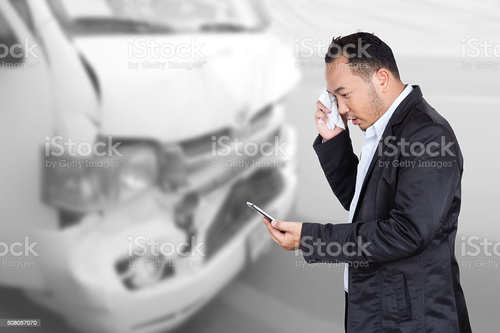 business man has auto accidents and phone call insurance stock photo