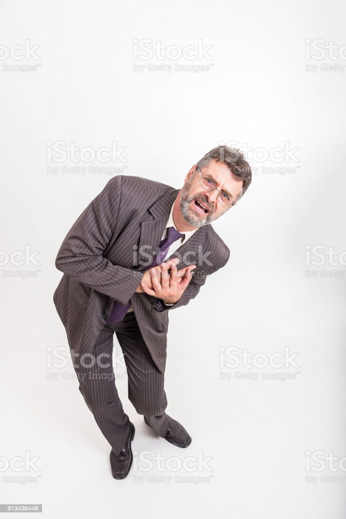 Business man having chest pain, heart attack, Healthcare and Medicine concept stock photo