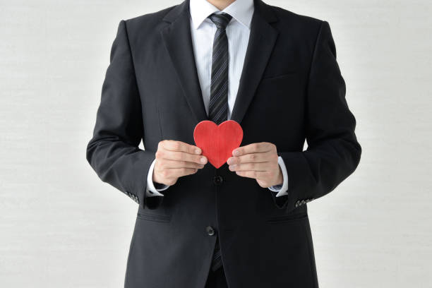 Business man having heart object stock photo