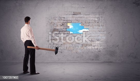 istock Business man hitting brick wall with hammer 1007257902
