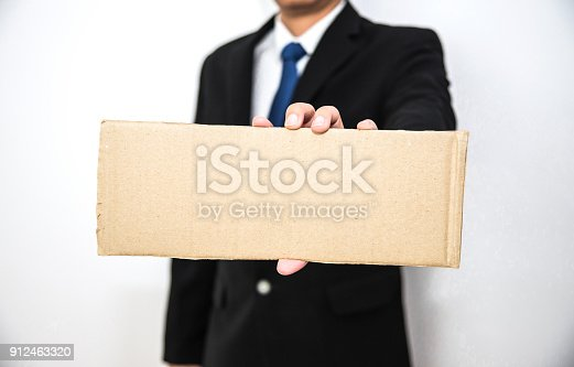 istock Business man hold blank cartboard paper on hand with isolated white background 912463320