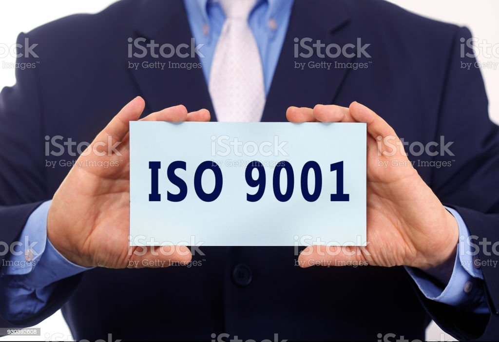 Business man hold paper ISO 9001 text on it stock photo
