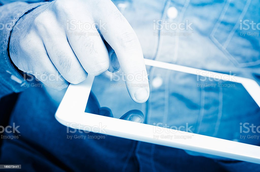 Business man holding a contemporary digital tablet royalty-free stock photo