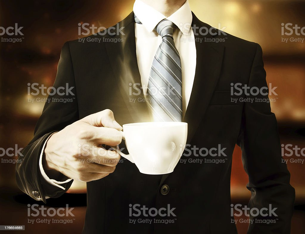 Business Man Holding a Cup of Coffee royalty-free stock photo