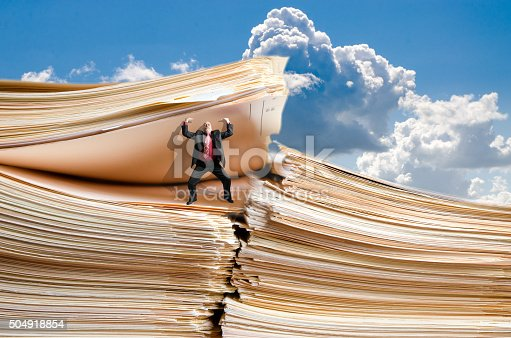481644192 istock photo Business man holding a giant pile of files 504918854