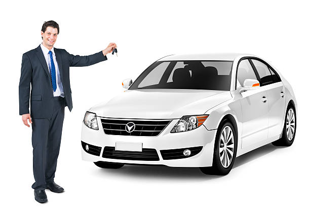 business man holding a key of the white car - used car selling stock pictures, royalty-free photos & images