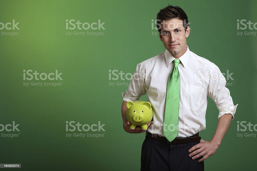 Business Man holding a Piggy Bank royalty-free stock photo