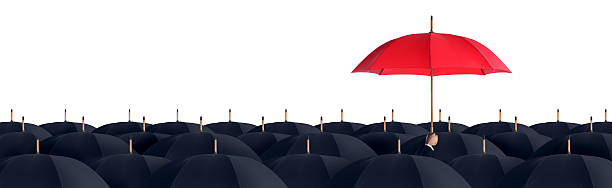 business man holding a red umbrella - protection stock photos and pictures