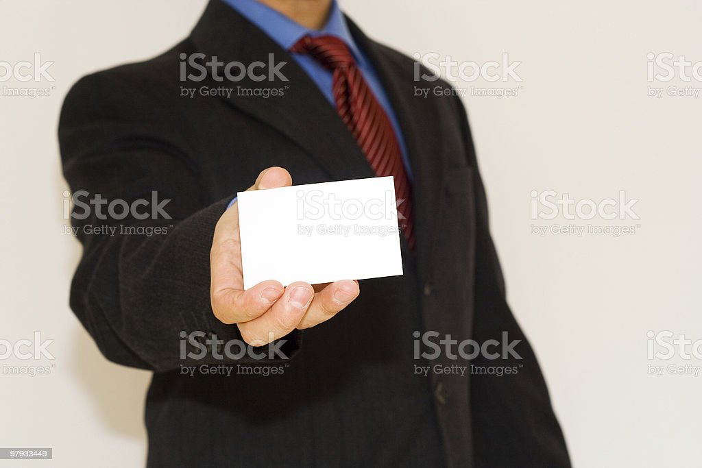 business man holding a white card royalty-free stock photo