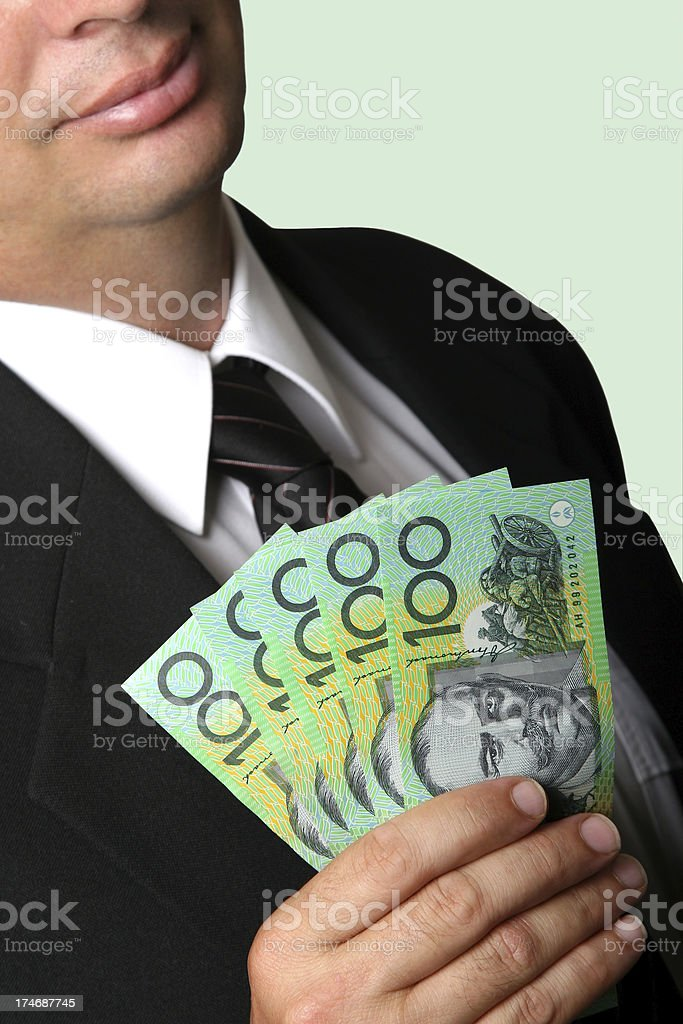 Business Man holding Australian money cash with green background greed stock photo