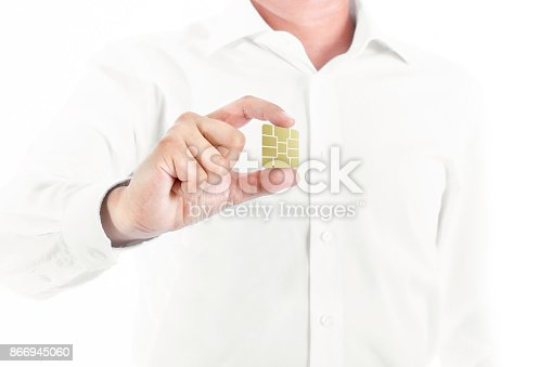 844190384 istock photo business man holding chip 866945060