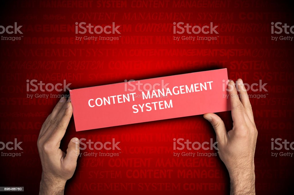 Business man holding Content Management System sing stock photo