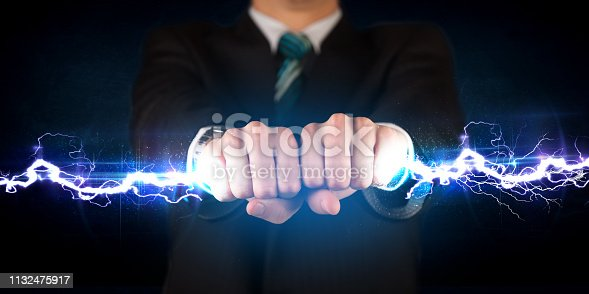istock Business man holding electricity light bolt in his hands 1132475917