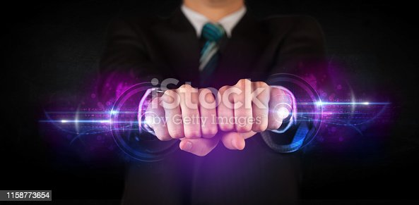 istock Business man holding future technology data system network 1158773654