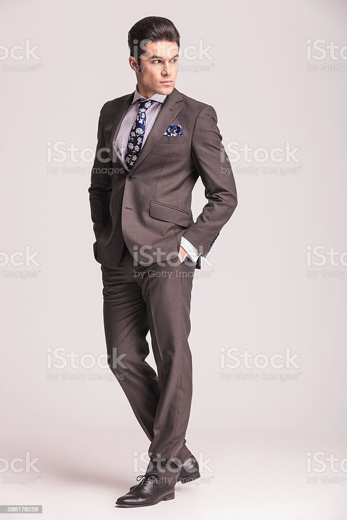 business man holding his hands in pockets stock photo