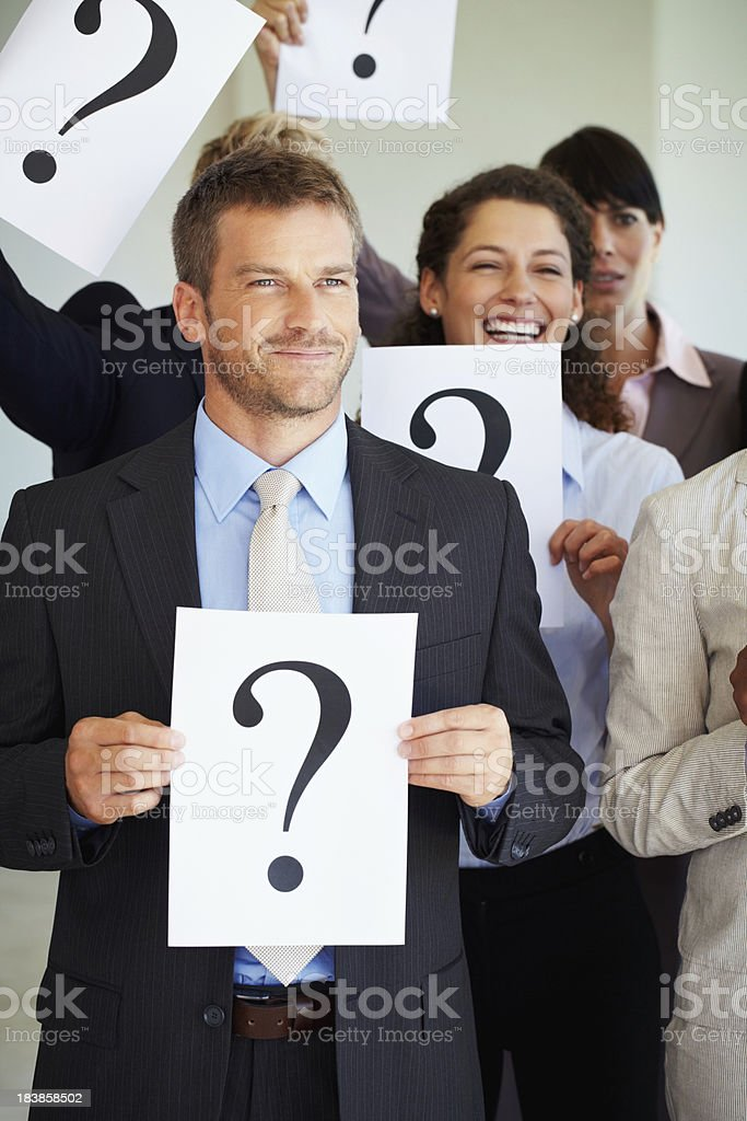 Business man holding question mark sign royalty-free stock photo